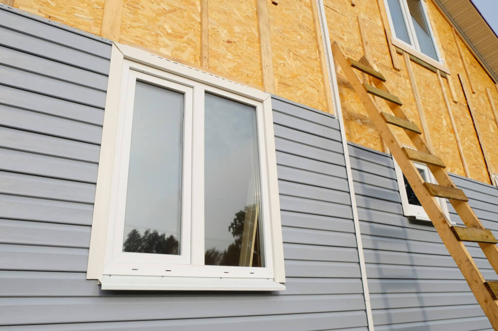 siding being installed on house